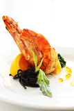 Griled prawn. A dish of grilled prawn with salad and squiz spaghetti, spread with white sauce and garnish with caviar Stock Images
