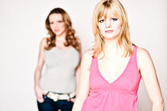 Grilfriends in portrait. Two girlfriends on a porait shoot standing in front of a white background Stock Photography