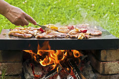 Grill. Barbecue in nature creates that extra touch in traditional food preparation Royalty Free Stock Photo