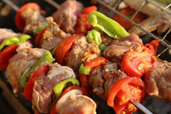 Grill. Bar-B-Q or BBQ with kebab cooking. coal grill of chicken meat skewers with mushroom and peppers. barbecuing dinner royalty free stock images