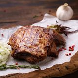 Grill and barbeque, ribeye steak, meat restaurant. Grill and barbeque, meat restaurant menu, juicy medium rare ribeye steak served with marinated onion on board stock photos