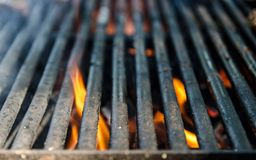 Grill bbq close up and bright hot flames, outside summer cookout, empty barbecue burning wood with smoke, blurred fire and charcoa stock photo