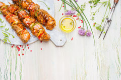 Grill or BBQ preparation with Meat skewers  and ingredients on light rustic background, top view Stock Photography