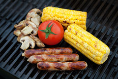 Grill bbq sausages and vegetables Royalty Free Stock Photo