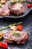 Grill beef steak. Portions thick beef juicy sirloin steaks on grill teflon pan or old wooden board Stock Photo