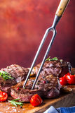 Grill beef steak. Portions thick beef juicy sirloin steaks on grill teflon pan or old wooden board Royalty Free Stock Image