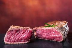 Grill beef steak. Portions thick beef juicy sirloin steaks on grill teflon pan or old wooden board Royalty Free Stock Photos