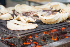 Grill big fresh squid over Barbecue grill for dinner Stock Photo