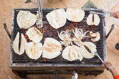 Grill big fresh squid over Barbecue grill for dinner Stock Photos