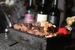 Grill and bottle of wine stock image
