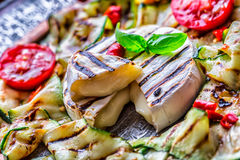 Grill Brie camembert cheese zucchini with chili pepper and olive oil. Italian mediterranean or greek cuisine. Royalty Free Stock Photography