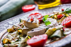 Grill Brie camembert cheese zucchini with chili pepper and olive oil. Italian mediterranean or greek cuisine. Royalty Free Stock Photos