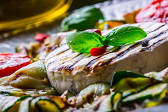 Grill Brie camembert cheese zucchini with chili pepper and olive oil. Italian mediterranean or greek cuisine. Stock Images