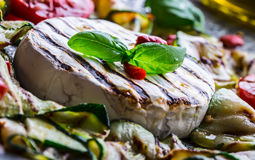 Grill Brie camembert cheese zucchini with chili pepper and olive oil. Italian mediterranean or greek cuisine. Stock Photography