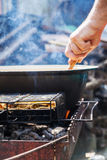 On the grill is a cauldron in which to cook meat and vegetables. Royalty Free Stock Photos