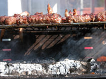 Grill and charcoal. Close shot of hot natural coal and a barbaque, meat on grill Royalty Free Stock Image