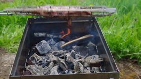 Grill with charcoal and flames stock video footage