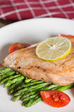 Grill chicken with asparagus, tomato and lemon slice. Selective Stock Photo