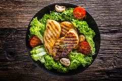Grill Chicken Breast. Roasted and grill chicken breast with lettuce salad tomatoes and mushrooms stock photos