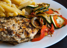 Grill chicken breast with vegetables. And french fries Royalty Free Stock Photo