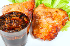 Grill chicken with mashed potato, cola, ice and vegetables on a plate. Stock Photos