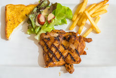 Grill chicken steak. On white plate Royalty Free Stock Photos