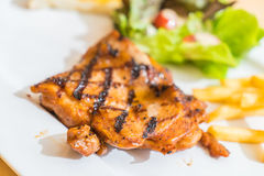 Grill chicken steak. On white plate Stock Photography