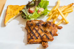 Grill chicken steak. On white plate Stock Images