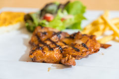 Grill chicken steak. On white plate Stock Photos