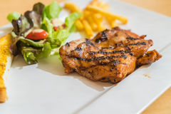 Grill chicken steak. On white plate Royalty Free Stock Photography