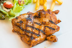 Grill chicken steak. On white plate Stock Image