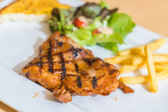 Grill chicken steak. On white plate Royalty Free Stock Images
