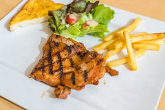 Grill chicken steak. On white plate Royalty Free Stock Image