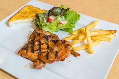 Grill chicken steak. On white plate Royalty Free Stock Photo