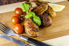 Grill chicken. With vegetables and cutlery and basil on wood plate royalty free stock photos
