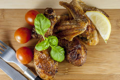 Grill chicken. With vegetables and cutlery and basil on wood plate stock image