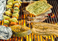 Grill cooking seafood long loaf, bread Royalty Free Stock Photos