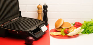 Grill for cooking on the table Stock Photos
