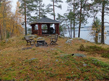 Grill. Cottage by the lake in the forest, renting for a weekend getaway. Finland royalty free stock photography