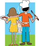 Grill Couple. A couple standing at a Barbeque waiting for their food to be cooked Royalty Free Stock Photography