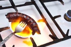 Grill in den Flammen Lizenzfreies Stockfoto