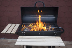 Grill on fire Stock Photo