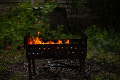 Grill firewood fireplace burn-out background barbecue stock photo