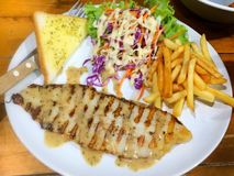 Grill fish. With Cream Salad Royalty Free Stock Photos