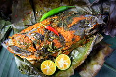 Grill Fish - Ikan Bakar. Ikan Bakar - Malaysian famous street food. Grill fish wrapped in banana leaf with a lots of spices Stock Photos