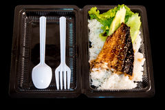 Grill fish on rice in plastic box, Take home food Stock Photos