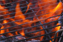 Grill & Flames. Just lighting the barbecue and the flames are coming up through the grill Royalty Free Stock Photos