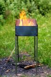 Grill in flames royalty free stock photo