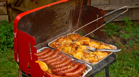 Grill food. Meat on the grill during a garden party Royalty Free Stock Images