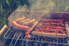 Grill. Fried meat on the grill Stock Photos